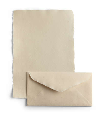 Sheet of paper and natural handmade envelope, isolated from the background.