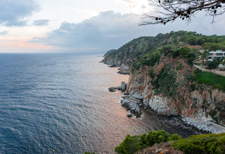 Cliff on the coast at sunset, View from a lookout point