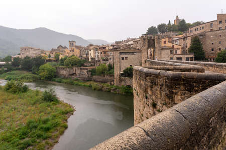 Medieval village in the rain, view of the river from a bridge