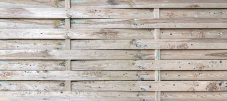 Wooden background with intertwined wooden slats, vintage wood