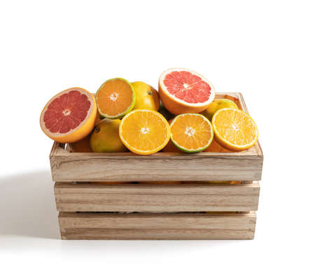 Wooden box with fresh seasonal fruits isolated from the white background 版權商用圖片