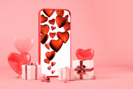 Valentines day concept, Mobile phone with gift boxes and hearts, pink background 版權商用圖片