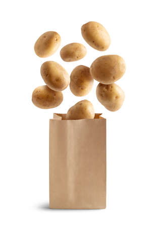 Potatoes flying in a recyclable paper bag isolated from the white background