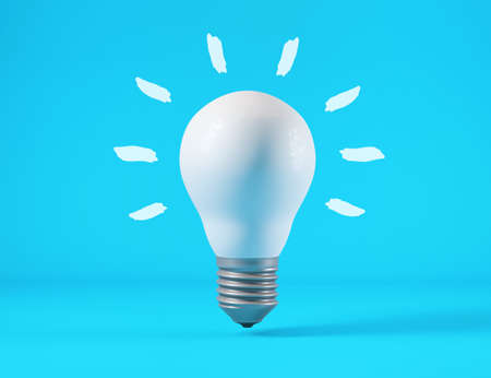 Light bulb isolated from blue background, idea concept Reklamní fotografie