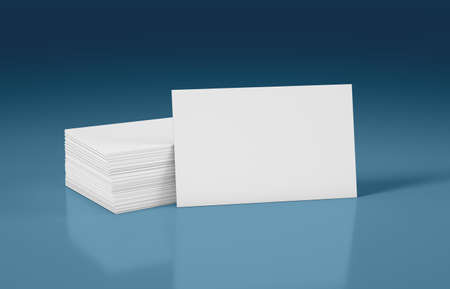Stack of business cards with front card for your design, blue background Reklamní fotografie