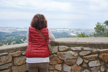 woman from behind seeing the landscape in a tourist place Reklamní fotografie