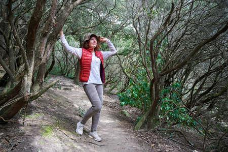 hiker woman posing on a stone in the mountain Reklamní fotografie