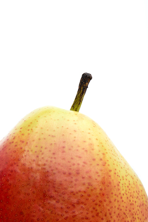 Closeup of a Corella pear isolated against a white background. 写真素材