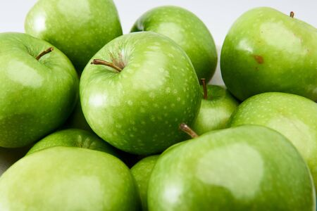 Close-up of a group of fresh green Granny Smith cooking apples.