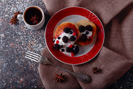 pancakes with fresh blueberries and coffee for breakfast, top view, horizontal
