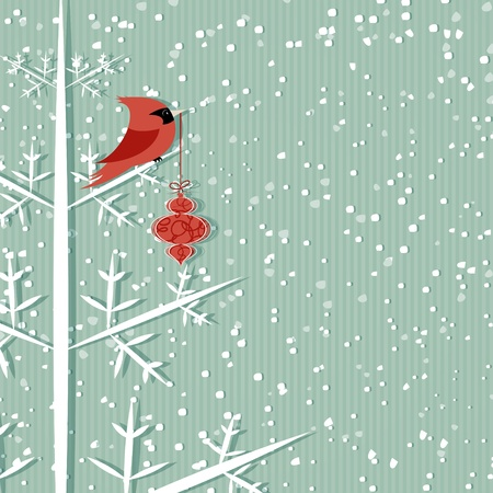 teal background: Winter background with red cardinal holding christmas decoration