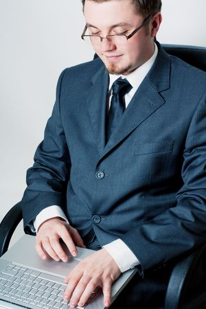 Business man with silver laptop on the chain  Stock Photo - 5738830