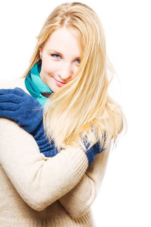 hilarity: portrait of a happy blonde young woman in a warm gloves (isolated)