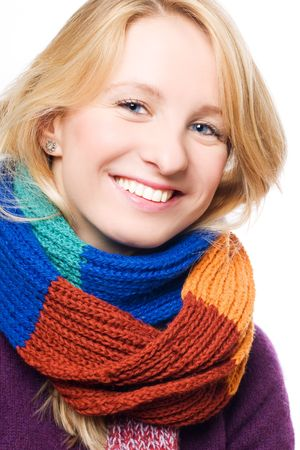 Portrait of a happy young woman in a scarf photo