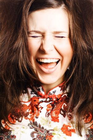 hilarity: portrait of a Beauty young woman with brown hairs scream Stock Photo