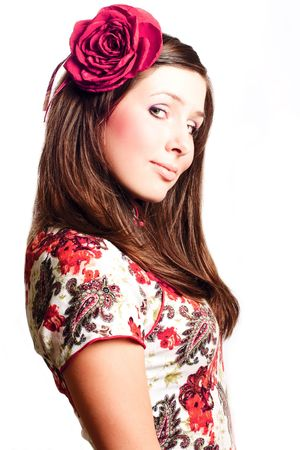 Portrait of a beautiful young woman with rose on the head (isolated) photo
