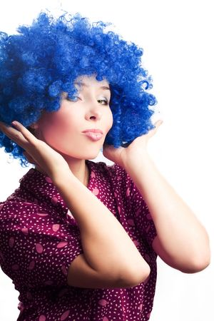 frolic: Portrait of a young woman in a blue wig of clown (isolated)