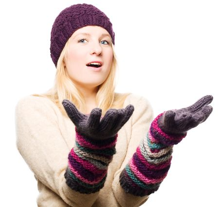 frostily: beauty young woman in gloves and cap shocked (isolated)