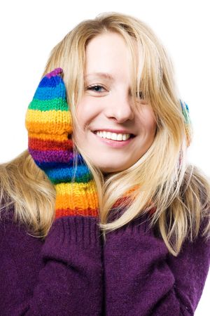 beautiful young woman in colourful gloves (isolated) photo