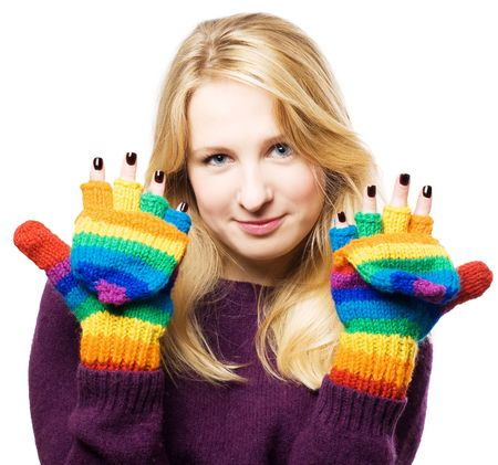 distantly: beauty young woman shows manicure in colourful gloves (isolated)