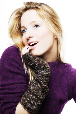 mated: portrait of beauty young sexy woman in winter gloves (isolated) Stock Photo
