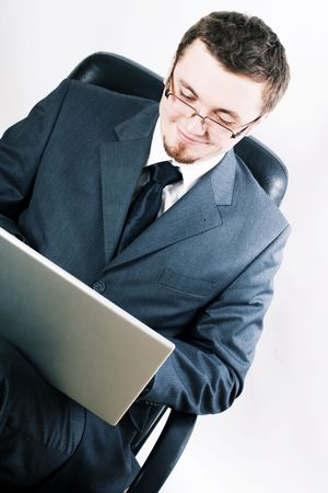 beauty young man in a eyeglass with laptop photo