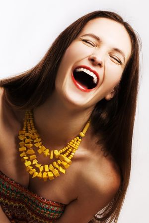 portrait of beauty laugh happy woman with yellow beads photo
