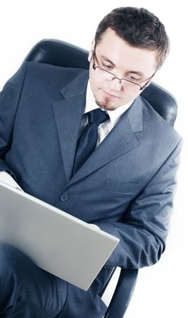 business man with laptop in glasses photo