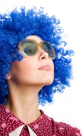 gaiety: portrait of happy woman in blue wig and funny dress