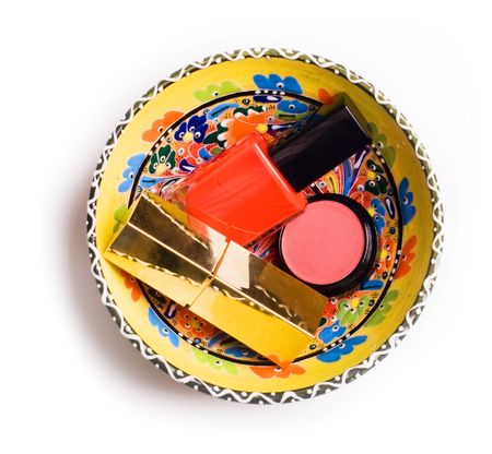 tube top: group of cosmetics in colorful plate isolated on a white background
