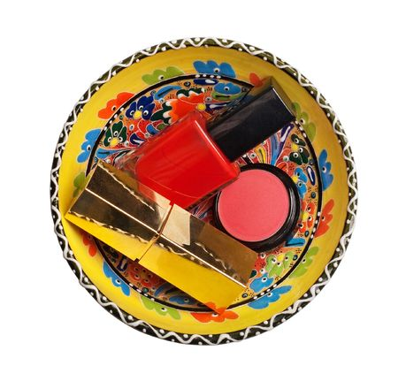 group of cosmetics in colorful plate isolated on a white background photo