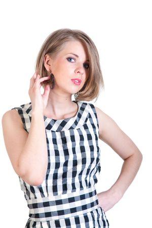primp: bella ragazza in orecchini in un abito in una gabbia (isolato)