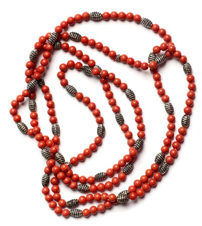 Indian retro necklaces from red coral isolated photo
