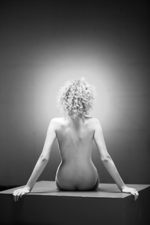 Nude back and body on young female in soft light