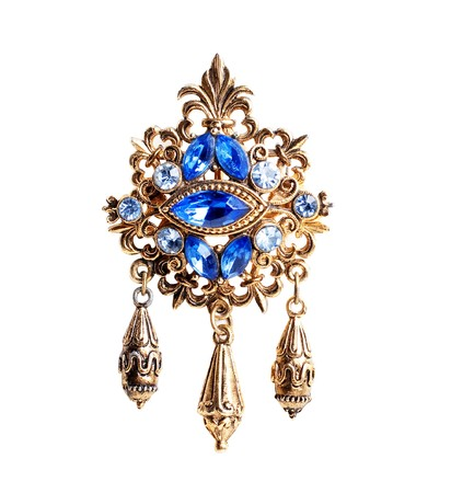 retro brooche with blue gems isolated on a white