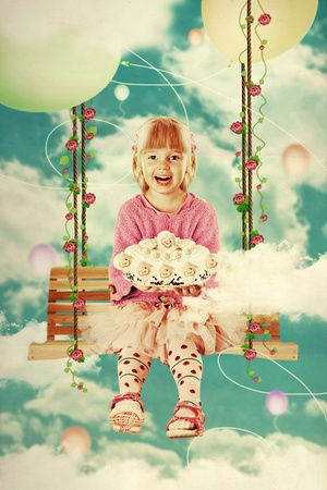 little girl on the swing in the sky with sweet cake Stock Photo - 8259752