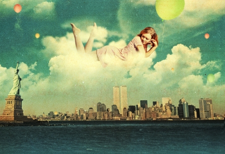 dreams of city: beauty woman in the clouds over new york city