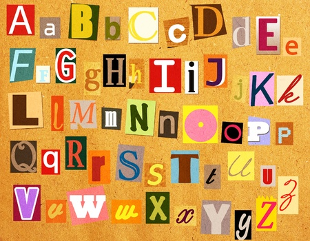 Colorful alphabet with letters torn from newspapers and magazines photo