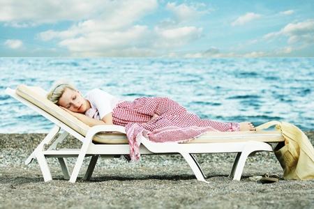 gir: woman sleep on beach near sea