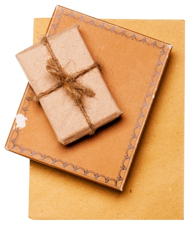 present gift from grunge paper isolated on a white photo