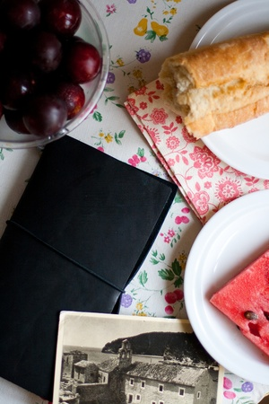 composition notebook: composition from bread, notebook and plum on the table