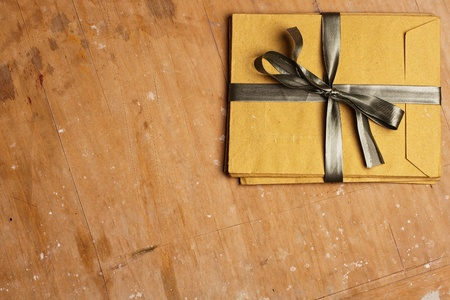 vintage envelopes with a bow on a wooden background Stock Photo - 8703473