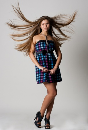 beauty young woman with good shape, and hairs on the wind Stock Photo - 8862089