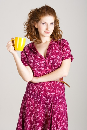 portrait of beauty young redhead woman with cup photo
