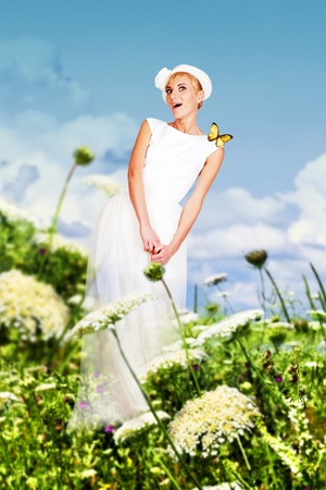 beauty young woman in white dress on the green meadow photo