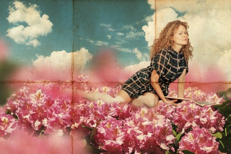 beauty young woman lie in pink flowers with book, vintage, retro pattern photo