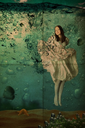beauty young woman in dress under water, vintage, retro pattern photo