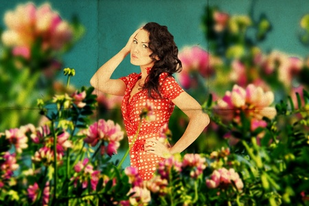 fairy image with beauty young woman in the flowers on the meadow photo