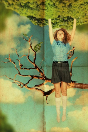 vintage collage with beauty woman on tree photo