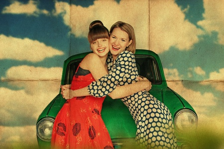 happy young women with retro car, vintage photo